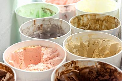 Plastic bins full of ice-cream in freezer, Pokomoke, Maryland.