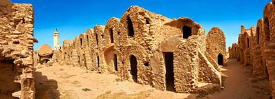 The northern Sahara ghorfa storage graneries of the traditional Berber mud brick fortified Ksar of Hedada or Hadada, near Tetouin, Tunisia, the settin...