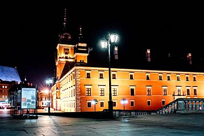 tourist area of the old town in night Warshawa Poland.