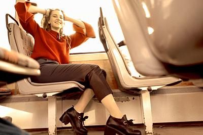 young happy woman sitting in public transport, in city Cottbus, Brandenburg, Germany.