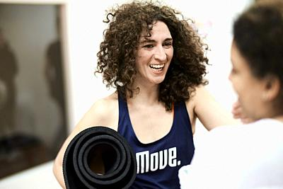 happy sporty women laughing in fitness studio