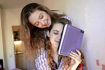 young tired women holding student notebook