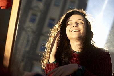 young happy woman in city