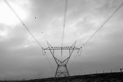 Elecrical cables supported by pylons, carry power across the country. Rural South Africa.