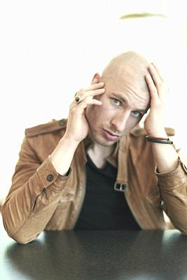 man touching bold head