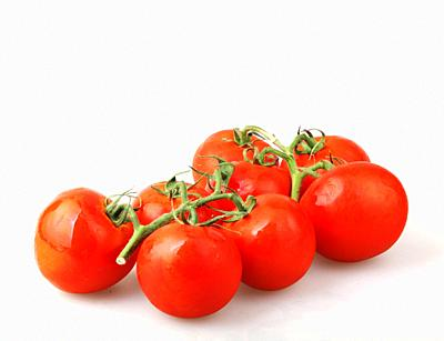 Close-Up Of Red Tomatoes On White Background.