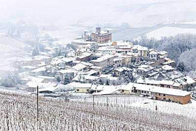 Langhe, Cuneo district, Piedmont, Italy. Langhe wine region winter snow, Barolo castle.