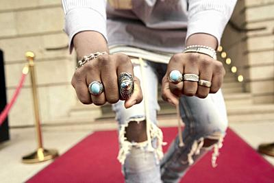 jewelry rings on hand of famous celebrity on red carpet