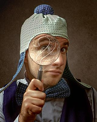 Nerd, Funny male portrait with magnifier loupe.