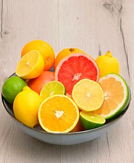 Colorful Assortment Of Citrus Fruit on Wooden Table.