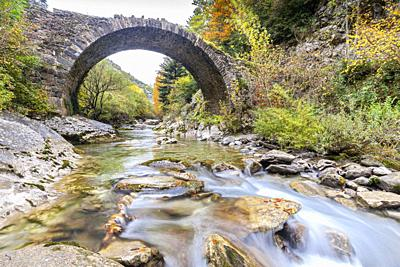 Romanesque bridge near Isaba in Belagua River, Roncal Valley, Navarra, Spain.