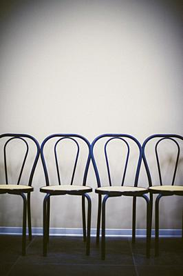Row of chairs against the wall.
