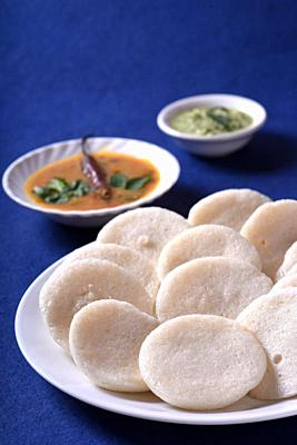 Idli with Sambar and coconut chutney on blue background, Indian Dish : south Indian favourite food rava idli or semolina idly or rava idly, served wit...