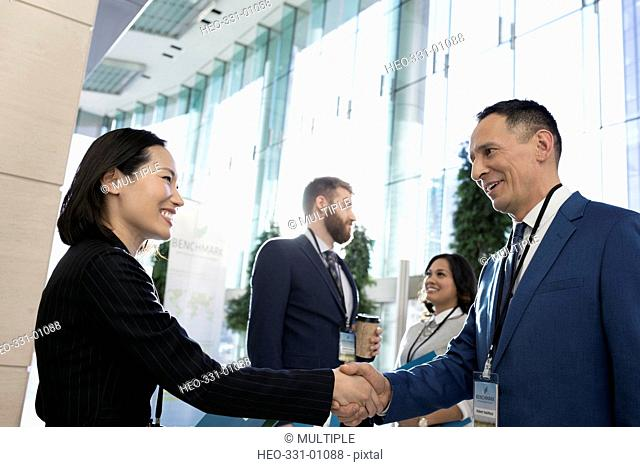 Business people handshaking, networking at conference