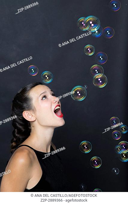 Mid-adult woman with soap bubbles