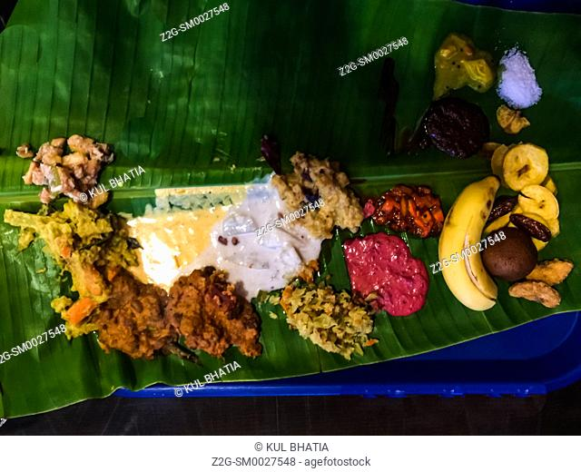 Vegetarian South Indian food served in a traditional way on a banana leaf, to be eaten with fingers