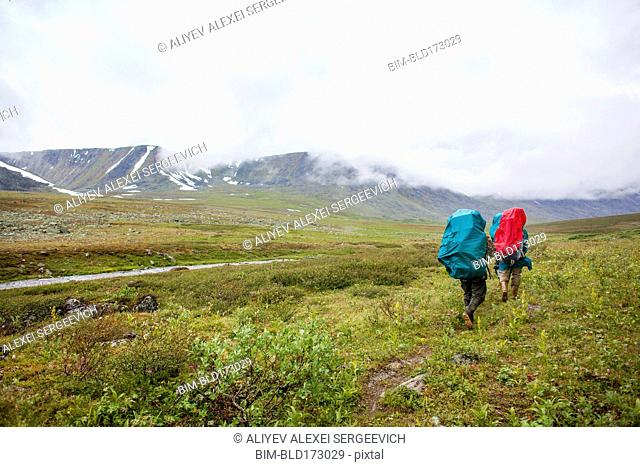 Backpackers walking on rural path