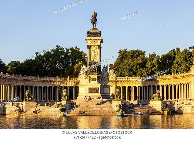 Lake and Alfonso XII monument, in Retiro Park. Madrid. Spain