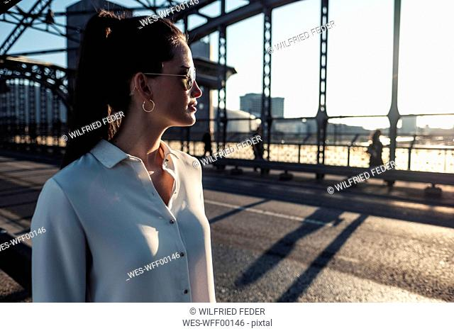 Young woman on a bridge in the evening light