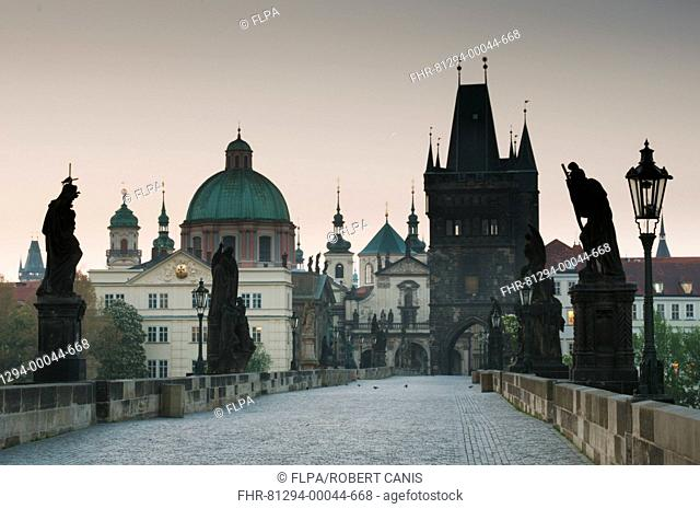 Statues on Charles Bridge (Karluv Most) at dawn, Vltava River, Prague, Czech Republic, May