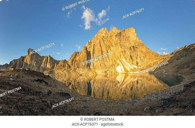 The morning sunlight hits Radalet Peak high in the Yukon Coast Mountains. Located about 25 minutes by helicopter from Carcross, Yukon