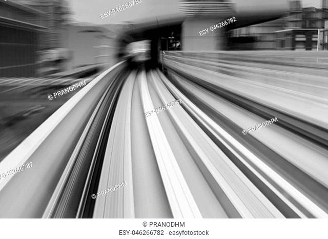 Black and White, Motion blurred sky train moving to tunnel, abstract background
