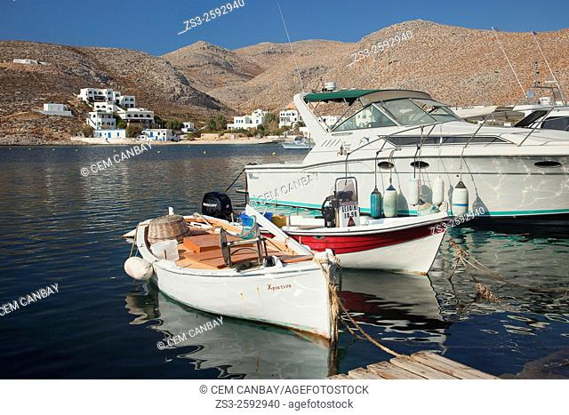 Fishing boats anchored at the pier close to the port, Folegandros Cyclades Islands, Greek Islands, Greece, Europe