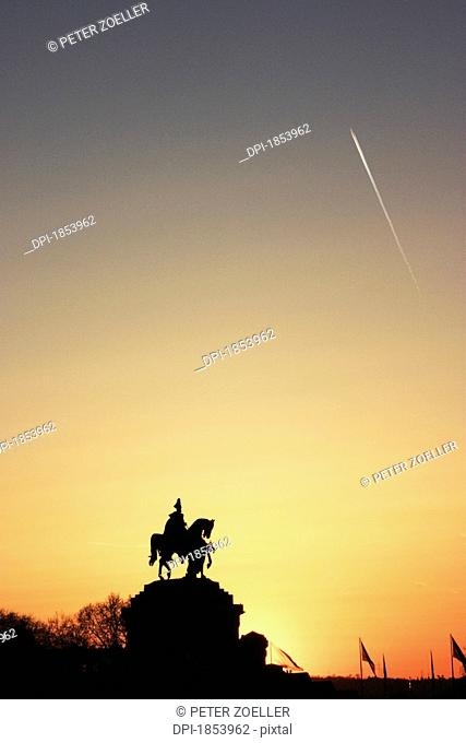 Shooting star over statue of a horse