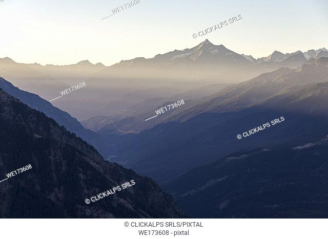 Panorama on Courmayeur and the central valley from Mont Chétif at sunrise, Aosta Valley, Italy