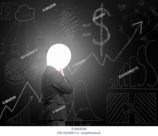 Thinking businessman with lamp head illuminated the dark business concept doodles blackboard background