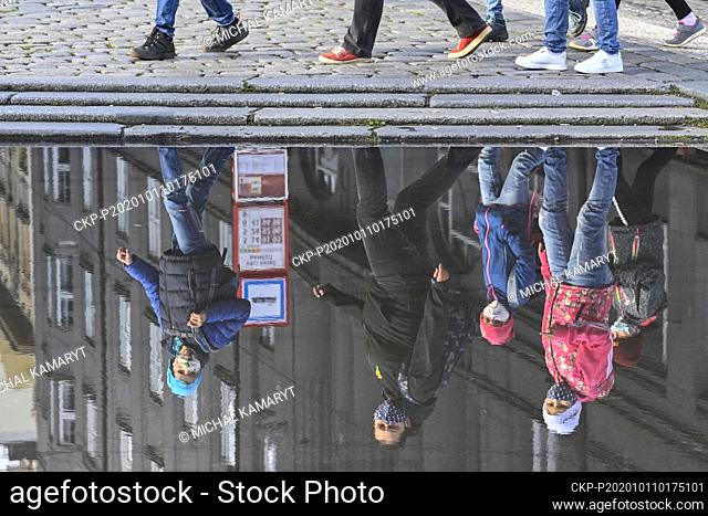 People stand queue the historical building of National Museum at Wenceslas Square for the Sun Kings exhibition, on Sunday, October 11, 2020