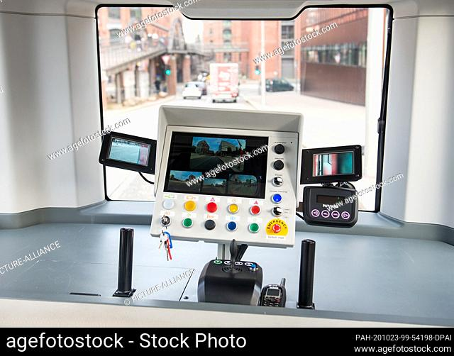 23 October 2020, Hamburg: View in HafenCity of controls in a Hamburger Hochbahn minibus driving without a driver. The first passengers have been able to use the...