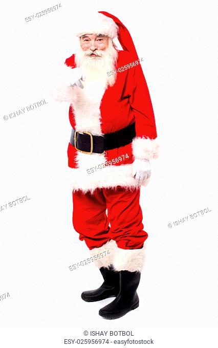 Full length shot of santa pointing at camera