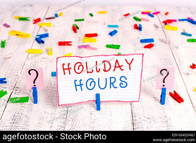 Handwriting text writing Holiday Hours. Conceptual photo employee receives twice their normal pay for all hours Scribbled and crumbling sheet with paper clips...