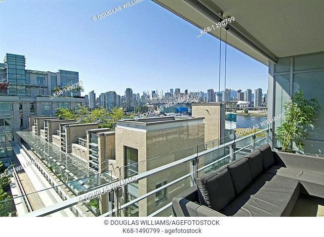 view from an apartment balcony toward downtown Vancouver, BC, Canada