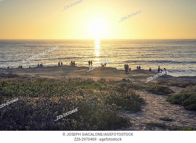 Group of people watching a coastal sunset. Sunset Cliffs Natural Park, San Diego, California