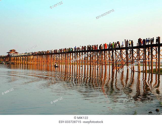 Famous U-Bein teak bridge at sunset on Taungthaman lake in Amarapura, Mandalay division, Myanmar