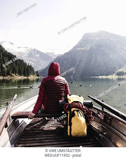 Austria, Tyrol, Alps, woman in boat on mountain lake