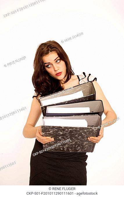 A beautiful young woman, lady, girl, secretary, personal assistant, office work, job, employee, worker, paper work, folders CTK Photo/Rene Fluger MODEL RELEASED