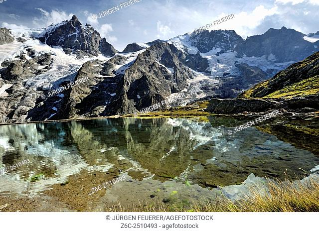 Panoramic view of the glaciers of La Meije, artificial lake on half height, Écrins, Hautes-Alpes, French Alps, France