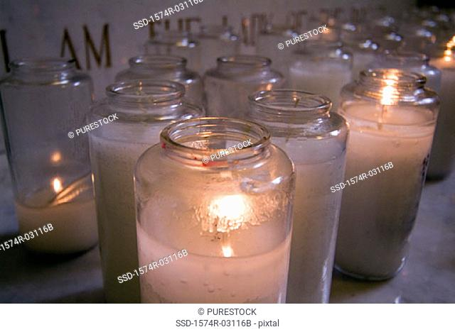 Close-up of lit candles in a church