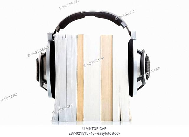 Audiobook concept - listen to your books in HD quality hi-end hifi headphones over multiple books on white