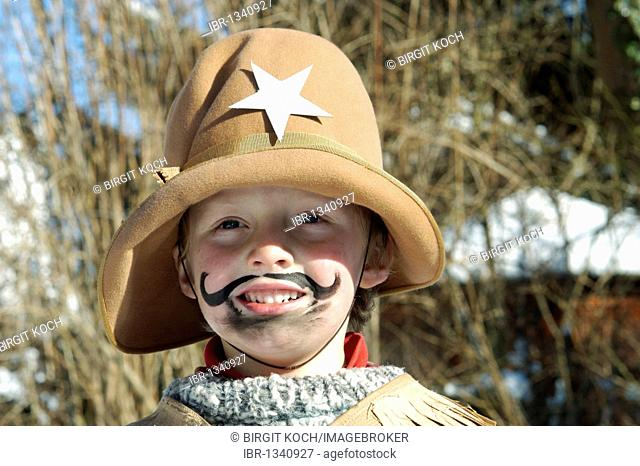 Boys, 5, dressed as a cowboy for Carnival