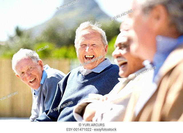 Portrait of a happy senior man laughing with his friends - Outdoor