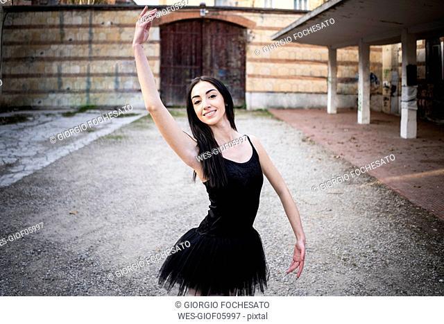 Italy, Verona, portrait of smiling Ballerina in the city