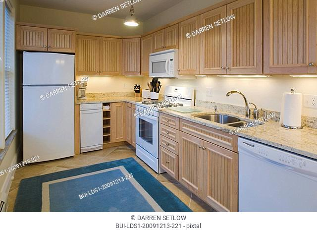 Traditional kitchen with light colored cabinets