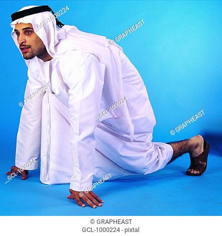 Arab man in starting position