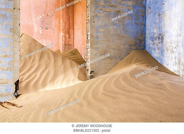 Sand piled in abandoned building