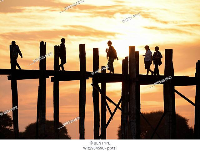 View of U-Bein Bridge at sunset, Amarapura, Mandalay, Mandalay Region, Myanmar (Burma), Asia