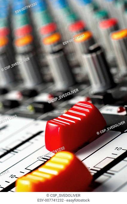Big red slider on a sound mixer